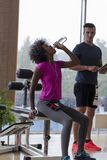 Couple in a gym have break Royalty Free Stock Image