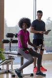 Couple in a gym have break Stock Photography