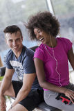 Couple in a gym have break. Healthy couple have break  at  crossfit gym african  american women with afro hairstyle Stock Image