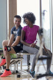 Couple in a gym have break. Healthy couple have break  at  crossfit gym african  american women with afro hairstyle Royalty Free Stock Image