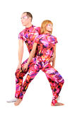 A couple of gymnasts. In colorful stage costumes Royalty Free Stock Photography