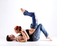 Couple of gymnasts posing on a light background Royalty Free Stock Images
