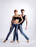 Couple of gymnasts posing on a light background Royalty Free Stock Photo