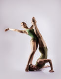 Couple of gymnasts in the studio Royalty Free Stock Images