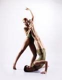 Couple of gymnasts training in a studio Stock Photos