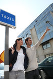 Couple hailing a cab Royalty Free Stock Photos
