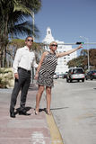 Couple hailing a taxi cab Royalty Free Stock Photo