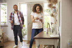 Couple In Hallway Returning Home Together Stock Photography