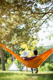 Couple in hammock from back Stock Photos