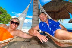 Couple on hammocks Royalty Free Stock Images