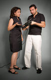 Couple with hand drill Royalty Free Stock Photos