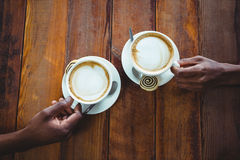 Couple hand holding cup of coffee Stock Photography
