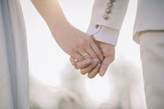 Couple hand on together. A bride and a groom hand on together Royalty Free Stock Photos