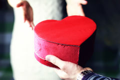 Couple hand valentine heart. Female hand holding object shape heart concept Stock Image