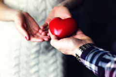 Couple hand valentine heart. Female hand holding a heart shape closeup Royalty Free Stock Photos