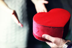 Couple hand valentine heart. Object red heart-shaped hands holding a young person Stock Image