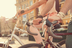 Couple hands on bikes Royalty Free Stock Photos