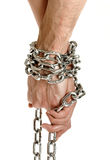 Couple hands chained together Royalty Free Stock Images