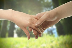 Couple hands closed together outdoors. Stock Photography