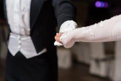 Couple hands dancing waltz at ball royalty free stock photos