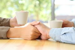 Couple hands dating and caressing in a bar Stock Photography