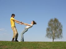 Couple with hands on grass Stock Images