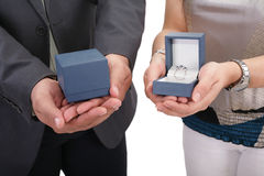 Couple hands holding boxes with rings. Valentines day Stock Image