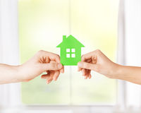 Couple hands holding green house Stock Image