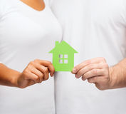 Couple hands holding green house Royalty Free Stock Image