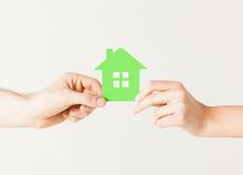 Couple hands holding green house Stock Photos