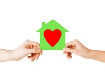 Couple hands holding green paper house Royalty Free Stock Photos