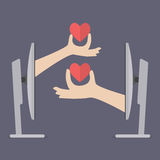 Couple hands holding hearts from two computers Stock Photos