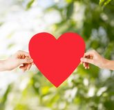 Couple hands holding red heart Stock Photo