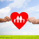 Couple hands holding red heart with family Stock Images