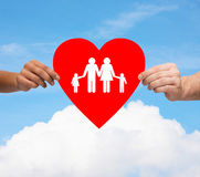 Couple hands holding red heart with family Stock Photography