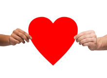 Couple hands holding red heart Royalty Free Stock Photography