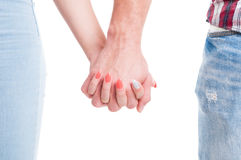 Couple hands holding together on white background Royalty Free Stock Images