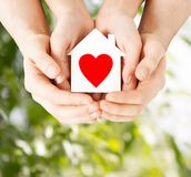 Couple Hands Holding White Paper House Royalty Free Stock Image