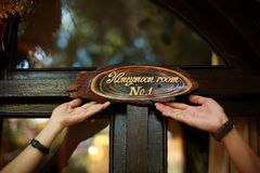 Couple hands and honeymoon room Royalty Free Stock Images