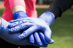 Couple of hands in the latex medical gloves. royalty free stock photos
