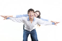 Couple with the hands lifted upwards Stock Photos