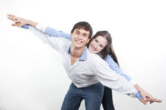 Couple with the hands lifted upwards Royalty Free Stock Image