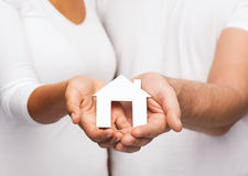 Couple hands with paper house Stock Photo