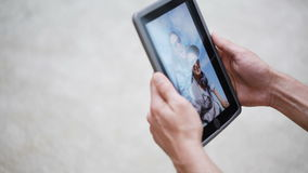 Couple hands with tablet pc viewing photos at home stock video
