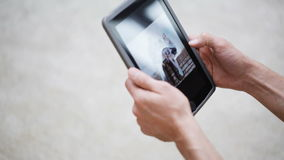 Couple hands with tablet pc viewing photos at home stock video footage