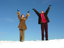 Couple with hands up. Winter royalty free stock photo