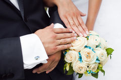 Couple hands on wedding. Symbolize forever togetherness and marriage closeup Royalty Free Stock Image
