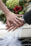 Couple hands with wedding ring before wedding car Royalty Free Stock Image