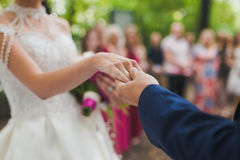Couple hands on wedding. Symbolize forever togetherness and marriage closeup Royalty Free Stock Photos