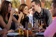 Couple hanging out with friends Stock Photo